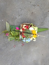 Traditional Balinese Hinduism Culture, an offering for God (include canang, rice, flowers, pandan leaf, and incense sticks) for celebrate Galungan Day in Gianyar, Bali, Indonesia