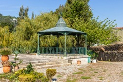 Traditional bandstand rotunda with a weathercock on top at large mansion estate near Esposende, Portugal.