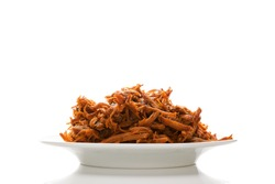 Traditional barbecue pulled pork on plate isolated on white background. Delicious meat eating.