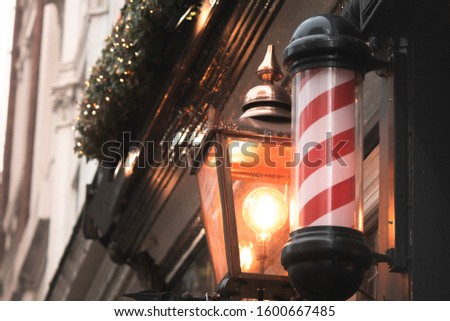 Traditional barber shop pole sign