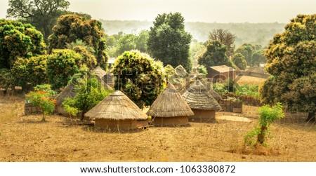 Traditional Bedik tribe bungalows in Senegal #1063380872
