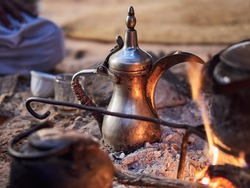Traditional Bedouin coffee with spices on fire