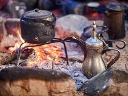 Traditional bedouin tea on fire in the Wadi Rum desert, Jordan