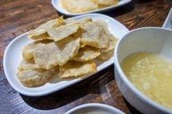 Traditional Beijing nosh - fried enema with mashed garlic.