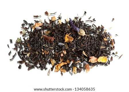 Traditional black dried tea with additions of petals like ginkgo biloba, sunflower, chamomile and dried fruits. Heap of leaves lying isolated on white background, horizontal orientation.