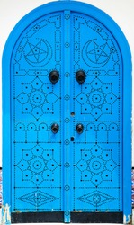 Traditional blue arched door from Sidi Bou Said in Tunisia. Large resolution