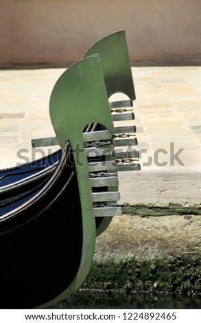 Traditional boat - iron prow-head of the gondola, famous vessel, Venice, Veneto, Italy; attraction, sightseeing, vacations, travel, romance, tourism. #1224892465