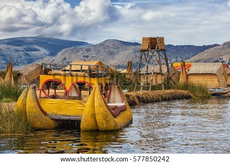 Traditional boat of local people on floating Uros island, Lake T #577850242