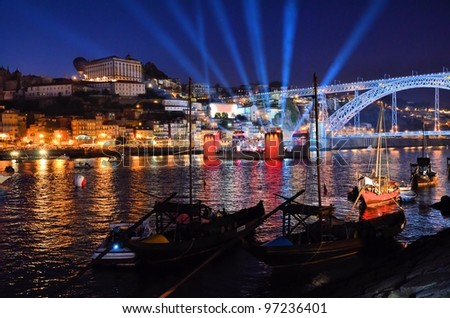 Traditional boats on the Douro river at night - stock photo