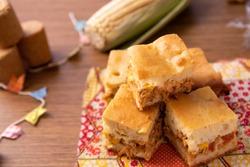 Traditional Brazilian Chicken Pie.  Tipical food from Brazil. June Party (Festa Junina) Brazilian Festival. Arraial Rustic Wood Background.