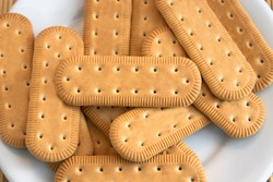 Traditional Brazilian corn starch biscuit called biscoito de maizena. Tipical cookie for afternoon coffee/tea. Corn starch biscuit on white plate