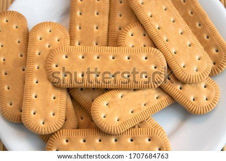 Traditional Brazilian corn starch biscuit called biscoito de maizena. Tipical cookie for afternoon coffee/tea. Corn starch biscuit on white plate Photo stock ©