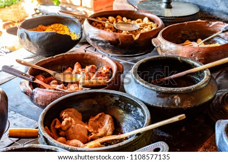 Traditional Brazilian food off the rgion off Minas Gerais being prepared in clay pots and in the old and popular wood stove