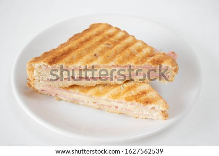 Traditional brazilian sandwich called misto quente on a plate on a white background Foto stock ©