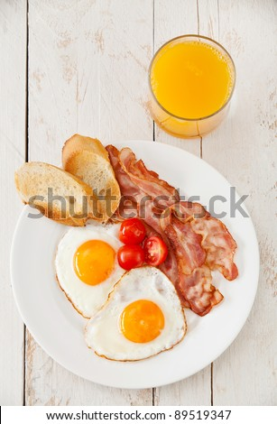Traditional  breakfast eggs with bacon