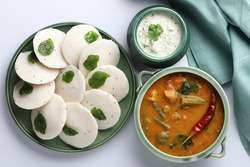 Traditional breakfast of South India IDLY served with sambar  Chutney in a ceramic plate
