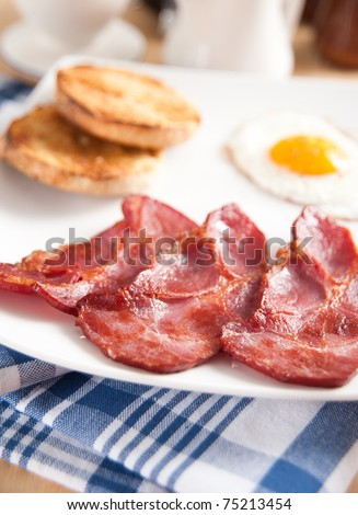 Traditional Breakfast with Canadian Bacon, English Muffin, and Fried Eggs