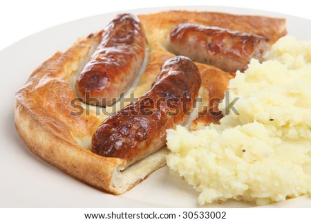 Traditional British dish of sausages baked in batter, aka 'toad in the hole'