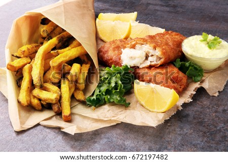 traditional British fish and chips on grey background