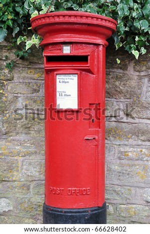 Traditional British Red Post Box on a London Street