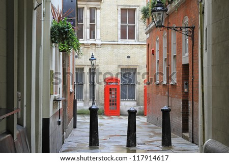 Traditional British red telephone boot at small street