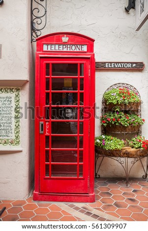 Traditional british red telephone box on a street
