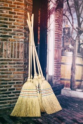 Traditional brooms outside of craft shop
