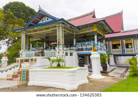 traditional building with colorful abstract