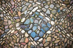 Traditional Bulgarian gravel pavement of colored river stones, photographed in the yard of a historic church in Pleven, northern Bulgaria
