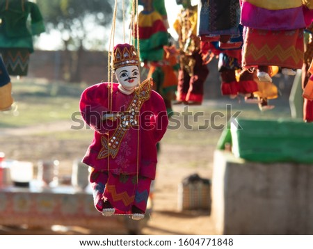 Traditional Burmese string puppet selling as souvenir in Bagan. The marionette was controlled above by wires or strings.
