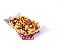 Traditional Canadian Poutine isolated on white background. Copy space