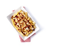 Traditional Canadian Poutine isolated on white background.Top view. Copy space