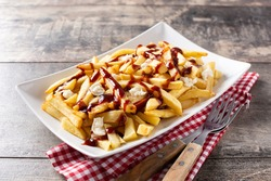 Traditional Canadian Poutine on wooden table