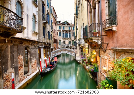 Traditional canal street with gondola in Venice, Italy #721682908