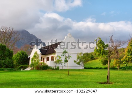 Traditional Cape Dutch house after rain. Shot in Helderberg nature reserve, near Somerset West, Cape town, Western Cape, South Africa.