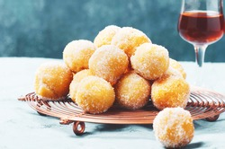 Traditional Carnival Italian fritters dusted sugar with honey and sprinkles.