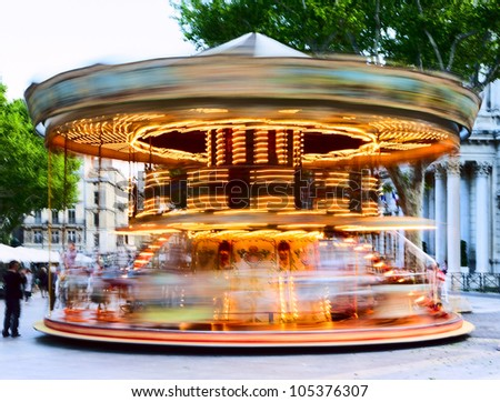 Traditional carousel with running horses for the children