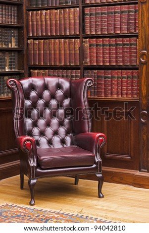 Traditional Chesterfield armchair in classical library room