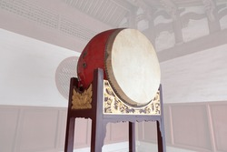 Traditional Chinese big drum on wooden frame with dragon relief in a temple, this traditional drum were usually pounded  in sacrificial rites or festivals in ancient times