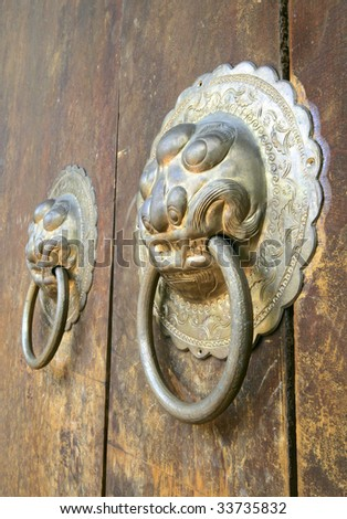 Traditional Chinese doorknockers - stock photo