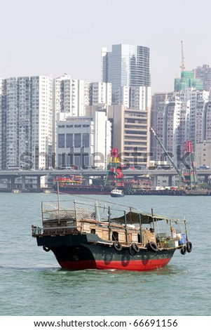 Traditional Chinese fishing junk in Victoria Harbor, Hong Kong
