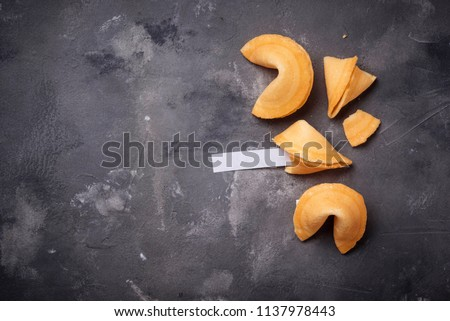 Traditional Chinese fortune cookies with prediction. Top view