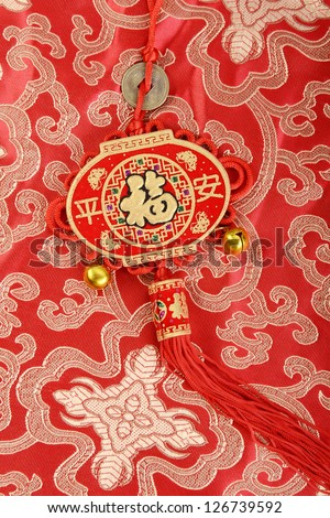 Traditional chinese knot,calligraphy mean happy new year
