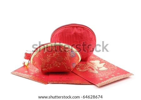 Traditional Chinese money bag and red envelope isolated on white.