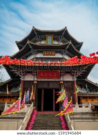 Traditional Chinese pagoda built in the ancient Chinese classical architecture style on the grounds of a Taoist temple in Hainan, China