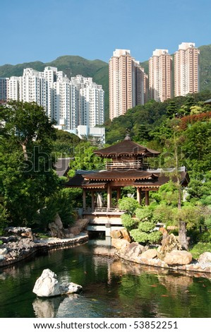 Traditional Chinese Pagoda in a garden setting contrasts with the modern skyscrapers on the hill behind.