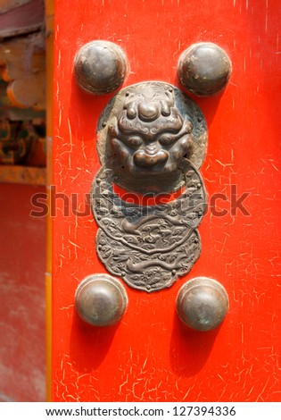 Traditional Chinese red door with a dragon (Jiaotu) head