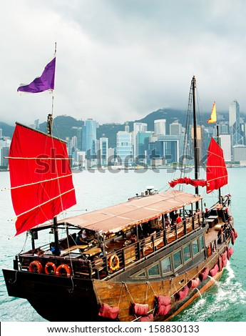 Traditional chinese-style sailboat sailing in Hong Kong harbor