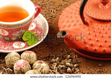 Traditional Chinese tea ceremony with kettle, cup and various kinds of tea