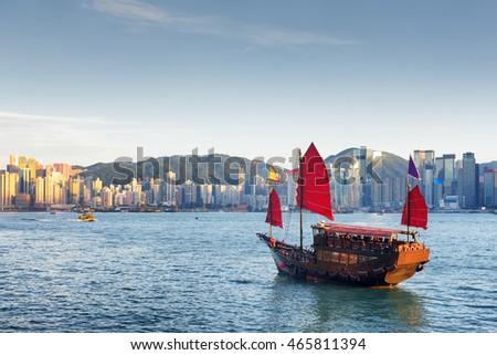Traditional wooden sailboat sailing in victoria harbor,Hong